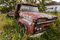 Wrecking car old in countryside in maine usa Royalty Free Stock Image