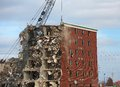 Wrecking of the holiday inn tearing down an old hotel with a ball Stock Photography