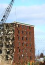 Wrecking of the holiday inn tearing down an old hotel with a ball Royalty Free Stock Photography