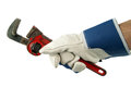 Wrench in hand with work glove Royalty Free Stock Photo