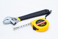 Wrench and measuring tape a on white background Stock Photography