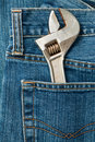 Wrench in a pocket Stock Photography