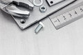 Wrench and standard ruler for hand work on scratched metallic ba Royalty Free Stock Photo