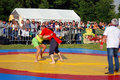 Wrestlers fight on ring moscow july sabantui celebration in moscow in kolomenskoye park sabantui is a national tatar and bashkir Royalty Free Stock Photo