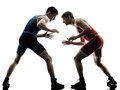 Wrestlers wrestling men isolated silhouette two caucasian on white background Stock Photos