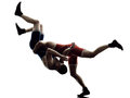 Wrestlers wrestling men isolated silhouette two caucasian on white background Royalty Free Stock Images