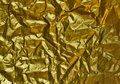 Wrinkled golden paper Stock Images
