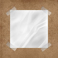 Wrinkled note on cork board paper with sticky tape Royalty Free Stock Photo
