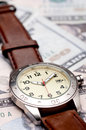A wristwatch on American currency Royalty Free Stock Photography
