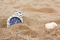 Wristwatch left discarded at the beach great for lost property or travel insurance Royalty Free Stock Image