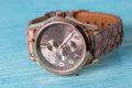 Wristwatch on old wooden table Royalty Free Stock Photography
