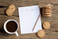 Write to do list on wooden table with chocolate chip cookie and coffee cup Royalty Free Stock Photo