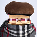Writer burlesque of a of detective novels books eyeglasses cap a scarf Royalty Free Stock Photo
