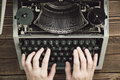Writer typing with retro writing machine. Royalty Free Stock Photo