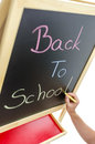 Writing back to school with various colors on blackboard Royalty Free Stock Photo
