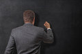 Writing on the board young businessman a blank blackboard Stock Photo