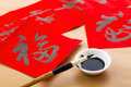 Writing Chinese calligraphy for Chinese new year, word Fu, mean Royalty Free Stock Photo
