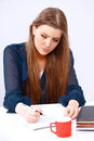 Writing girl pretty with busy thoughtful expression Royalty Free Stock Photo