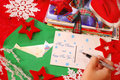 Writing greeting cards for christmas Royalty Free Stock Photo