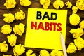 Writing text showing Bad Habits. Business concept for Improvement Break Habitual Hebit Written on sticky note paper, wooden backgr Royalty Free Stock Photo