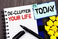 Writing text showing De-Clutter Your Life. Business photo showcasing Free Less Chaos Fresh Clean Routine written on notebook book Royalty Free Stock Photo