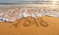 Written on the beach golden sands Stock Photo