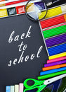 Written on the blackboard back to school and supplies for Royalty Free Stock Images