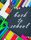 Written on the blackboard back to school and supplies for Stock Image