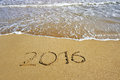 2016 written on sand beach - happy new year concept Royalty Free Stock Photo