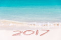 2017 written on the sand of a beach, travel new year concept Royalty Free Stock Photo