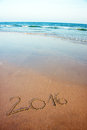 2016 written in sand on tropical beach