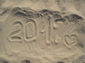 Written on a sandy beach in the afternoon