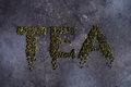 Written tea on a black background.