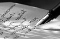 The written word a close up photo of a fountain pen and writing on ruled paper Royalty Free Stock Photos