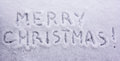 stock image of  Written words merry Christmas on a white snowy background