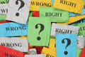 Wrong or right crumpled colorful paper notes with words and question marks Royalty Free Stock Images