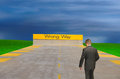 Wrong way sign with confused lost man Royalty Free Stock Photo