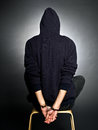 Wrongdoer a man with handcuffs on black background Stock Image