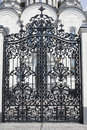 Wrought gates. Image of a decorative cast iron gates. metal gates close up. beautiful gates with artistic forging. Image of god an Royalty Free Stock Photo