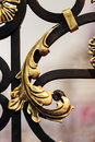 Wrought iron details of structure and ornaments of fence and gate Stock Photography