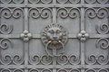 Wrought iron door with lion face on at the bavarian national museum in munich Royalty Free Stock Image