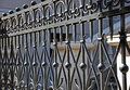 Wrought iron fence close up look of in front of the modern building Royalty Free Stock Images