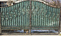 Wrought iron gate with green mesh opaque Royalty Free Stock Images
