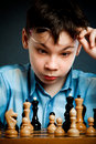 Wunderkind  play chess Stock Photography