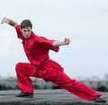 Wushoo man in red practice martial art Stock Photos