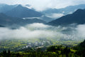 Wuyuan spring beautiful rape and terraces mist shrouded Royalty Free Stock Photography