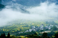 Wuyuan spring beautiful rape and terraces mist shrouded Stock Photo