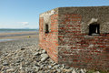 Ww defence bunker a red brick constructed from the second world war looking out to sea Stock Photography
