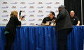 Wwe world heavy weight champion photo of roman reigns www at the washington dc auto show on here he is having his picture taken Stock Images