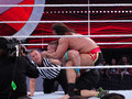 Wwe wrestler rusev puts john cena in the accolade santa clara march with ref checking during wrestling match for usa Royalty Free Stock Photography